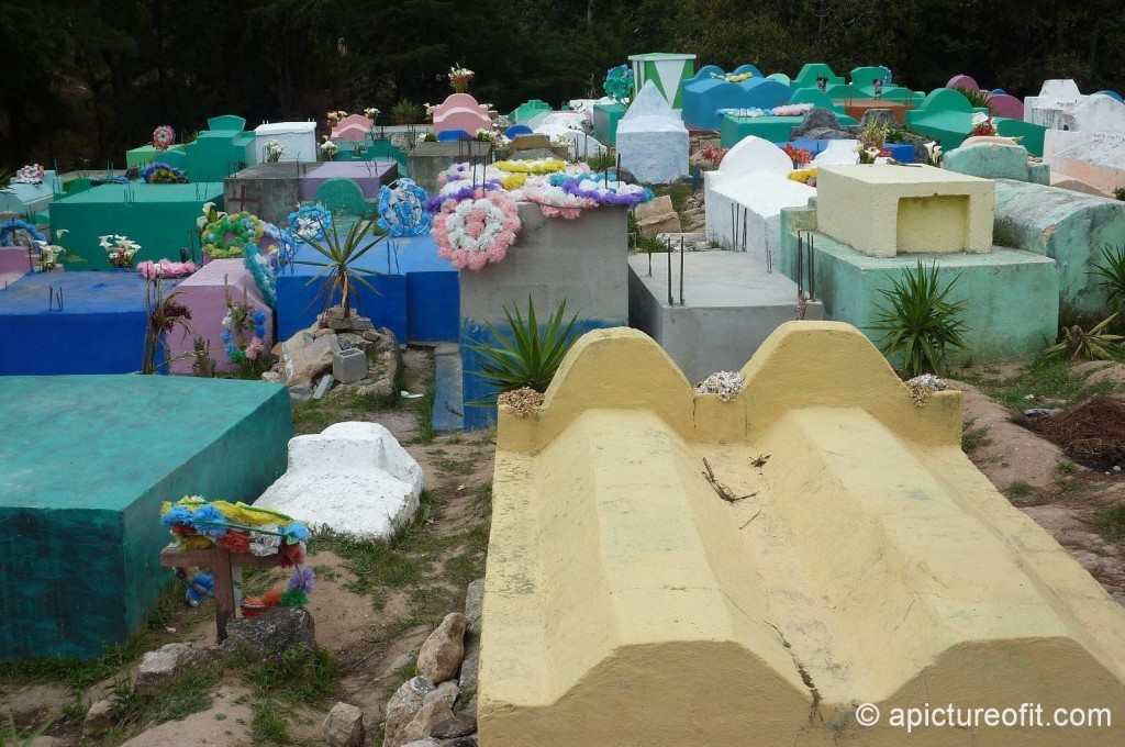 Glorious explosions of color decorate the hillside cemetery in Uspantán