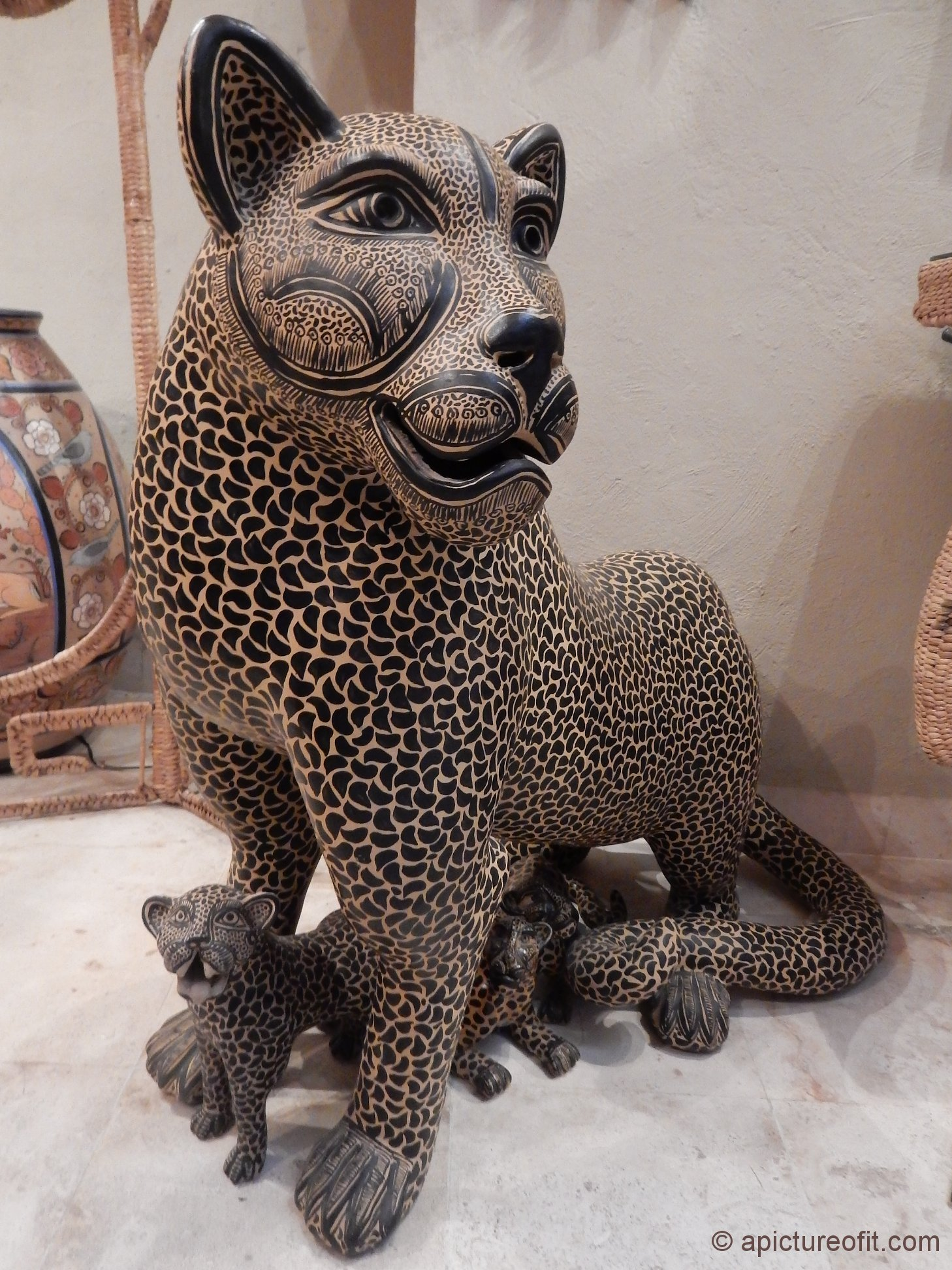 The Jaguar is an important symbol of power and strength in the Yucatan. This beautiful piece is of solid clay.